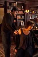 Damon checking Rose's wound
