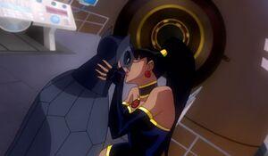 Owlman and Superwoman kiss