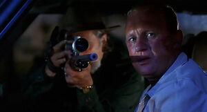 Strasser aiming at Jill