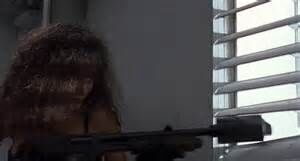 Angie fires the Grenade Launcher