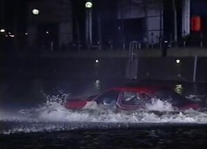 Don drives into the canal
