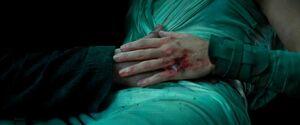 Rey holds Ben's hand