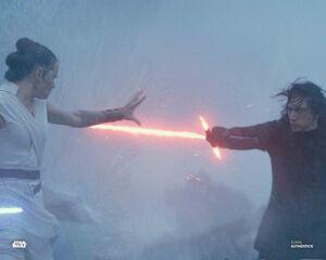 Rey stops Kylo's saber