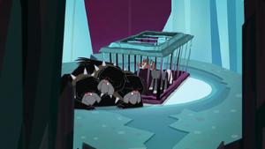 Cerberus lying next to Tirek's cage S8E26