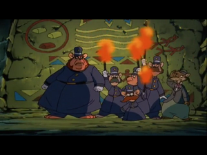 McBrusque and his enforcers enter the cave