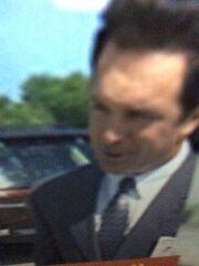 Mark McKinney about to hit joe Scheffer in the parking lot .jpg