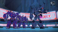 Cyclonus Speaks to Treadshock and Riotgear