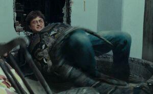 Nagini traps Harry in her coils
