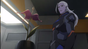Lotor looks at the flower