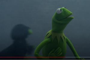 Constatine seaking behind Kermit