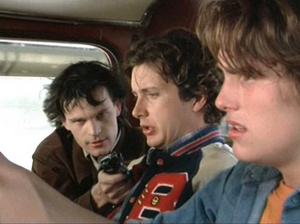 Tex and Mason at gunpoint