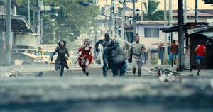 The Suicide Squad runs towards Starro
