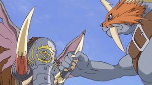 Zudomon grabs Mammothmon's Tusk