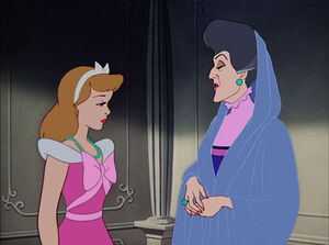 Cinderellla getting picked on by her stepmother over her dress