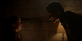 August threatens Beth in the basement