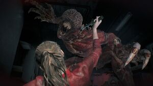 A Licker attacks Claire in Resident Evil 2 (2019)