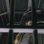 Indoraptor in cage 2.png