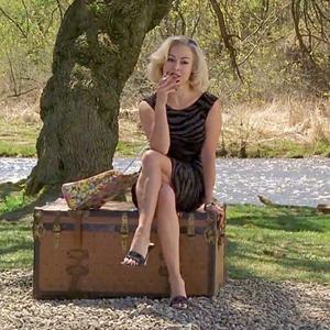 Tiffany Valentine sitting on the trunk