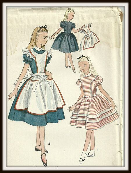One Piece dress and pinafore Alice in Wonderland dress. 1951