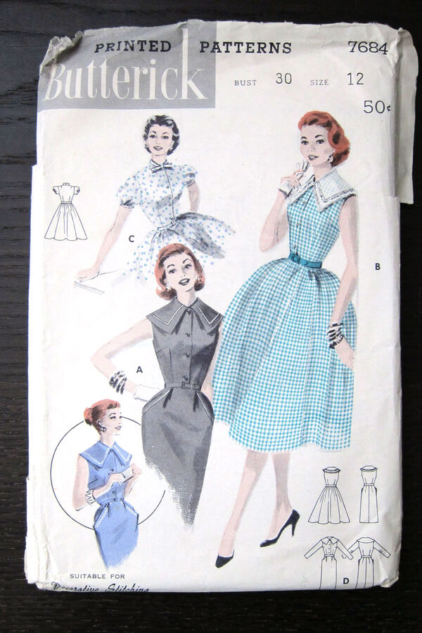 Dress: Choice of Skirts. (A) Sleeveless sheath has capelet collar and peg pockets trimmed with braid or fashion stitching. (B) Contrast, lace trimmed collar, full skirt. (C) Border print, bow tie neckline, short puffed sleeves. (D) Long sleeves sheath with cepelet collar.