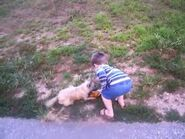 William and Lucy play with a dog and then go for a walk