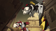 S7E05.92. Black and Red towering over ruins