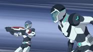 S4E04.162. Lance and Shiro mock fighting the stage beast