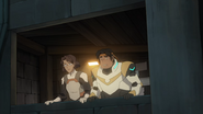 S7E09.352. Veronica and Hunk look out on the Galra internment camp