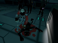 Arcad Callous April 18th 2020 5 RG-2 inspects bullet wounds on a corpse