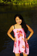 35273177-japanese-american-woman-with-hands-akimbo-smiling (2)