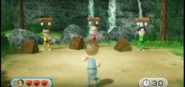 Asami, Eddy, and Takumi participating In Lumber Whacks in Wii Party