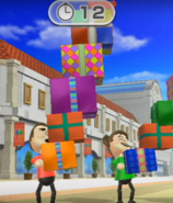 Rainer and Midori participating in Shifty Gifts in Wii Party