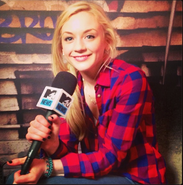 Emily in MTV so beautiful with red plaid shirt as always