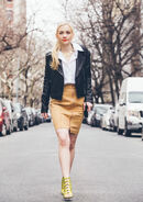 Emily walking like a boss in a black jacket and gold bottom