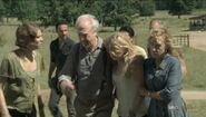 Beth being carried by her dad and Patricia