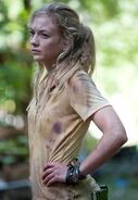 Beth with a different cute yellow shirt in still