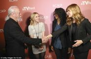 Scott and Emily greeting and meeting with other actors