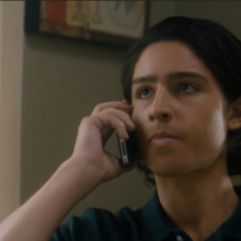 Chris on the phone to Travis, he doesn't look happy either.png