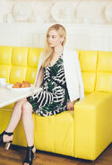 Emily Kinney so cool and beautiful in a yellow sofa