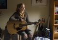 AMC 509 Beth Playing Guitar