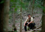 AMC 603 Rick Sitting in Woods.png