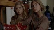 Lizzie and Mika holding Tyreese