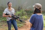 Sasha Williams Receives A Sniper Rifle from Rosita 7x14 Promotional Still