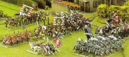 An army of mercenaries attacrs an Ork borde