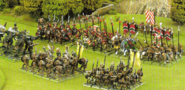 A bestman warband charges a Dogs of War army