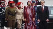 Escorted by Female Bodyguards, Gaddafi Visits Kyiv