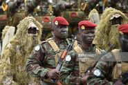 Ivorian soldiers from the Parachute Commando unit parade during celebrations marking the 58th anniversary of Ivory Coast's independence from France on August 7, 2018