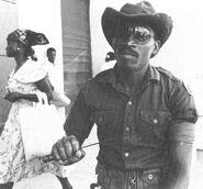 Tonton Macoute brandishing machete.