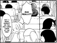 Ucchi sits next to Tomoko