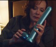 Laurie holding Excalibur Sex Toy in S1E3